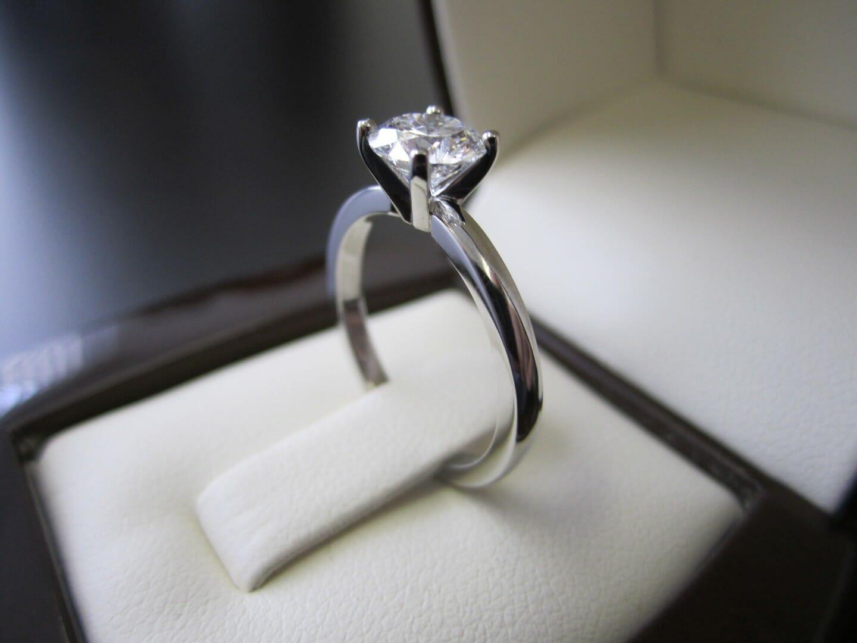 Picture of Classic Solitaire Engagement Ring in Platinum with 0.90ct Round Brilliant Diamond